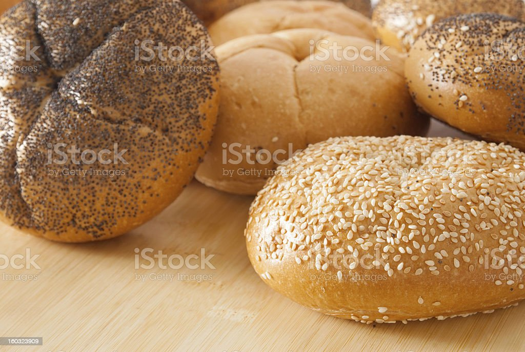 assortment of kaiser roll breads with seeds and some plain stock photo