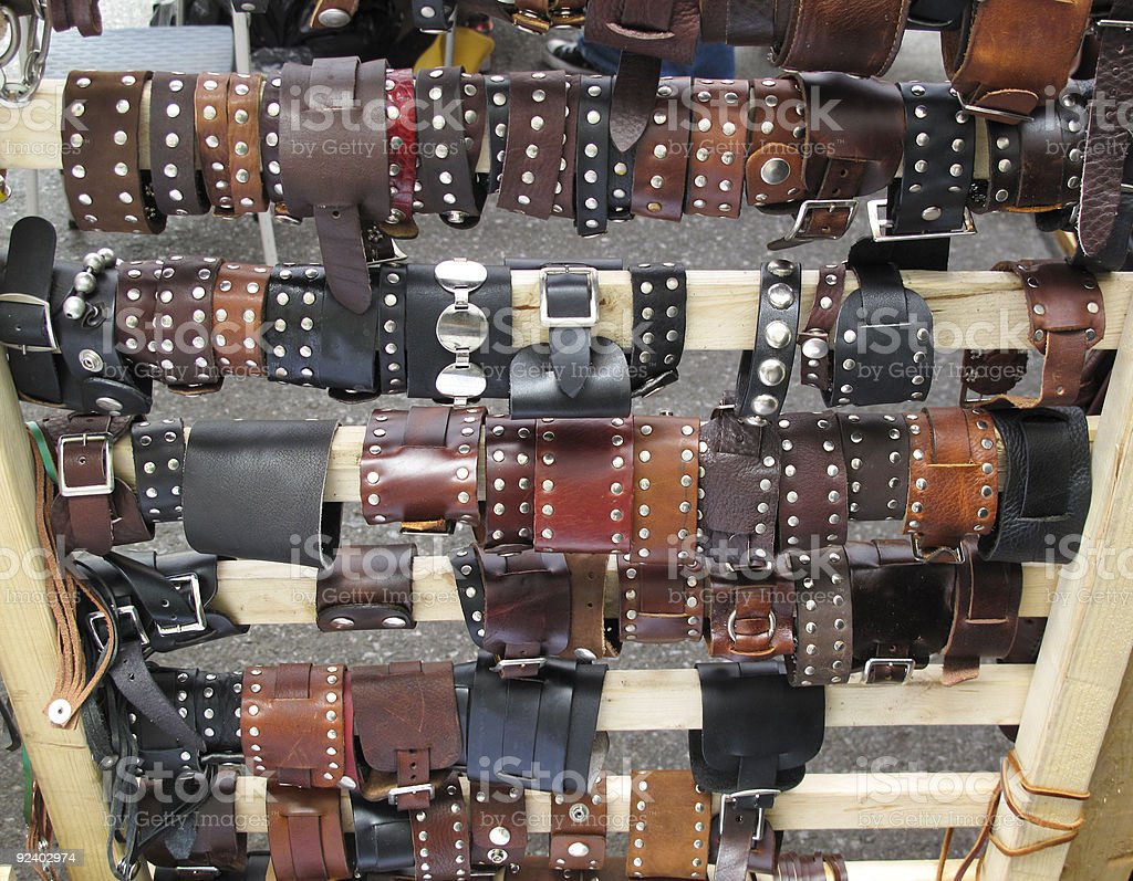 Assortment of leather wrist cuffs stock photo