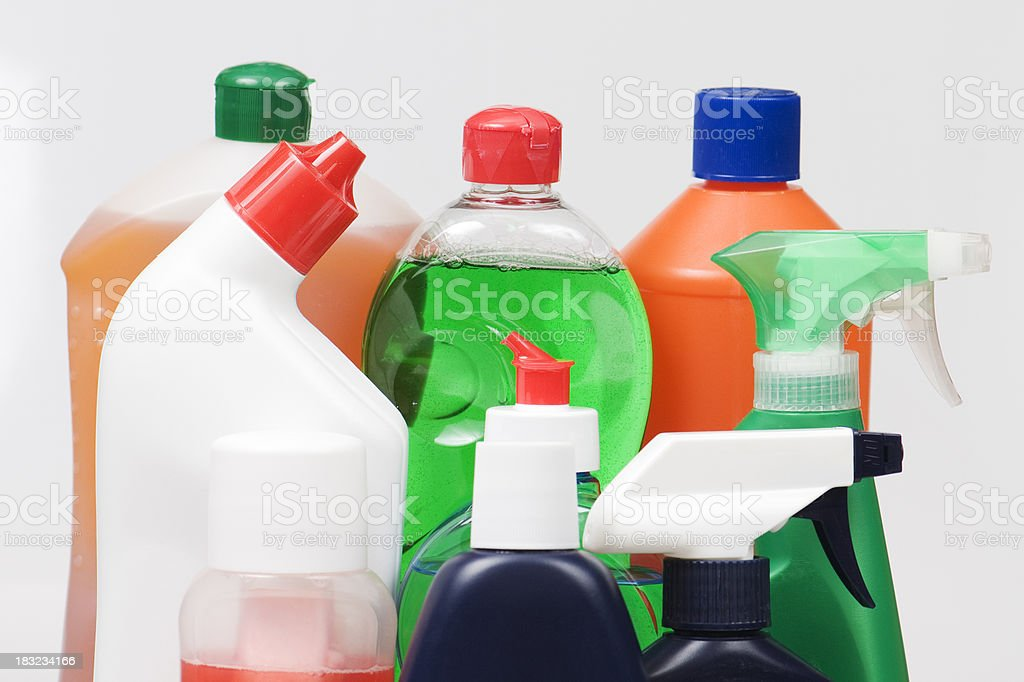 Assortment of liquid cleaning products in plastic bottles royalty-free stock photo