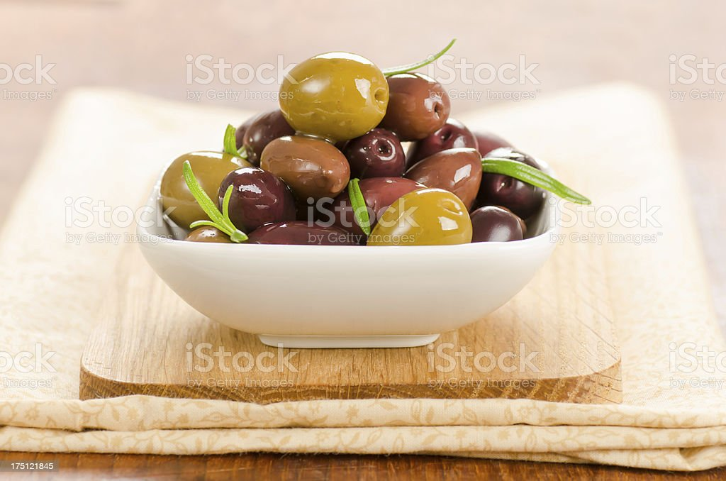 Assortment of marinated olives in a small bowl stock photo