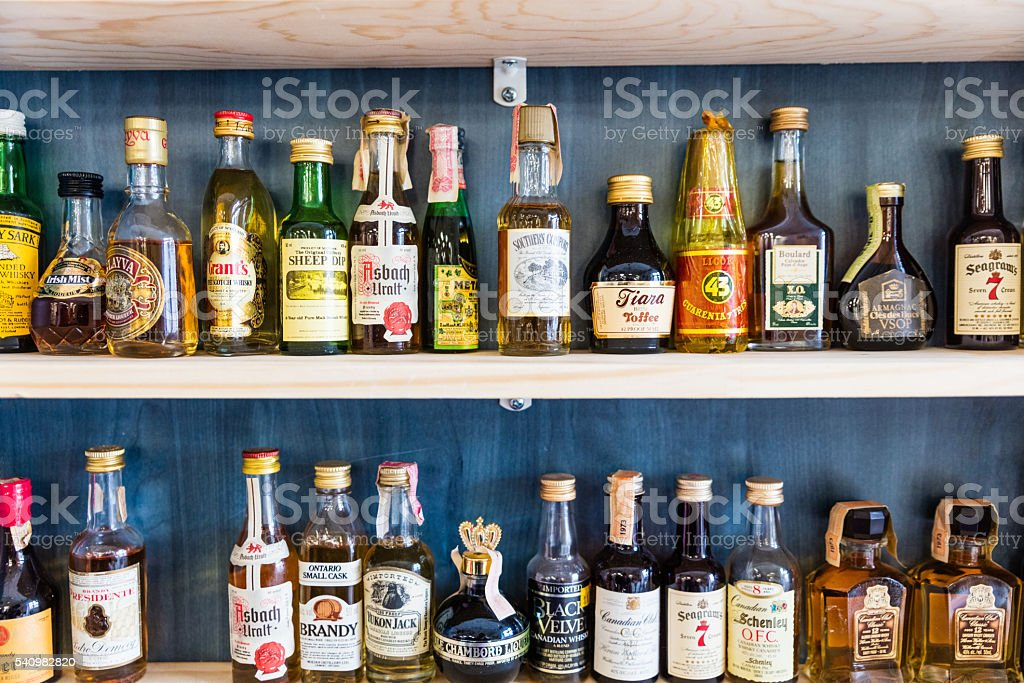 Assortment of mini bottles of alcohol stock photo