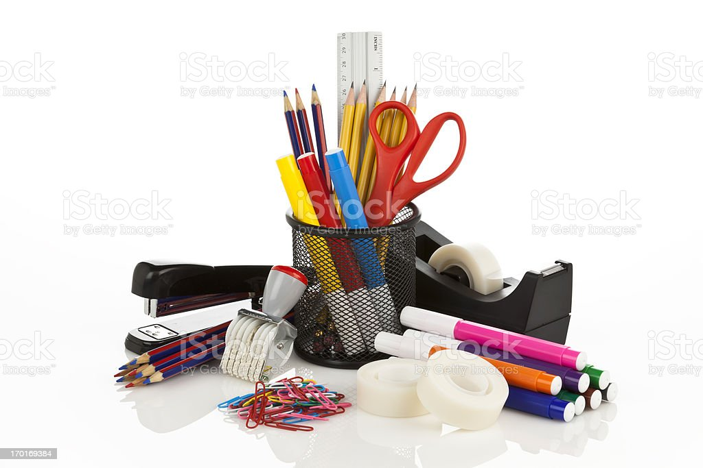 Assortment of office supplies on white backdrop stock photo