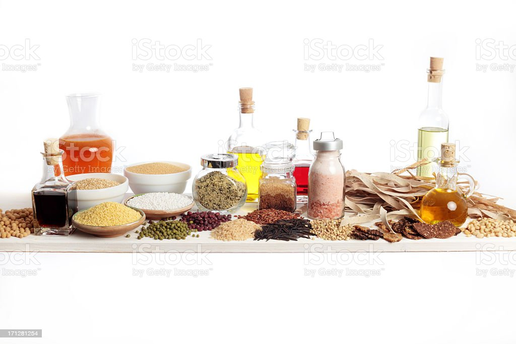 Assortment of organic spices and foods on white background stock photo