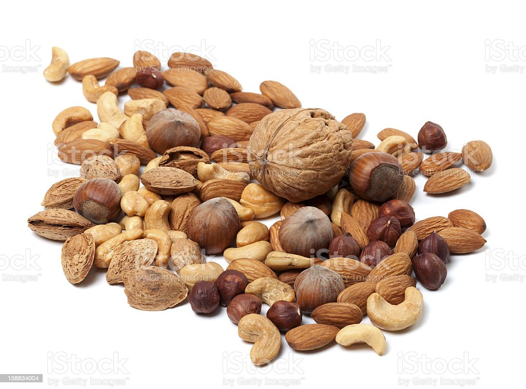 Assortment of raw and roasted nuts stock photo