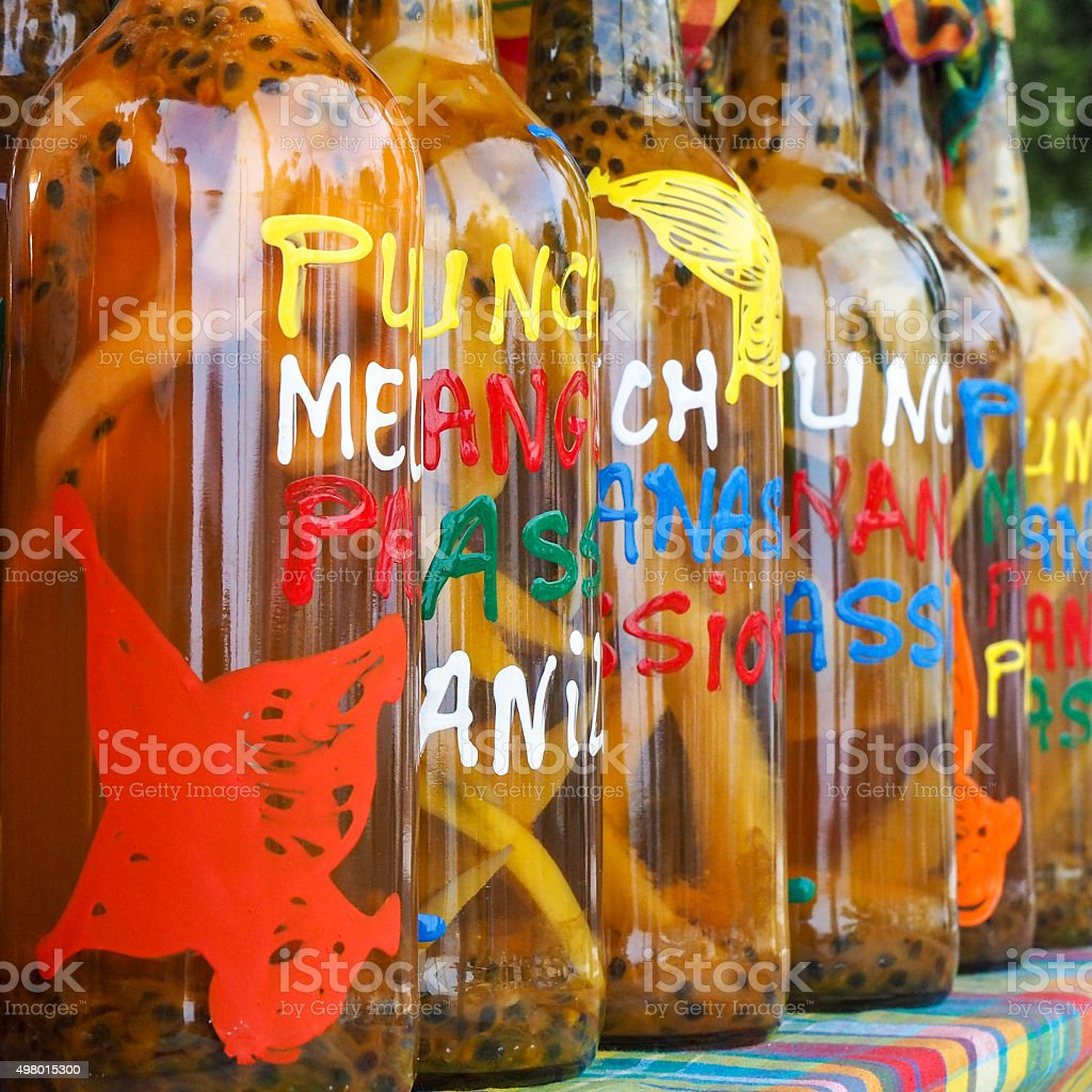 Assortment of rhum bottles at the market, squared format stock photo