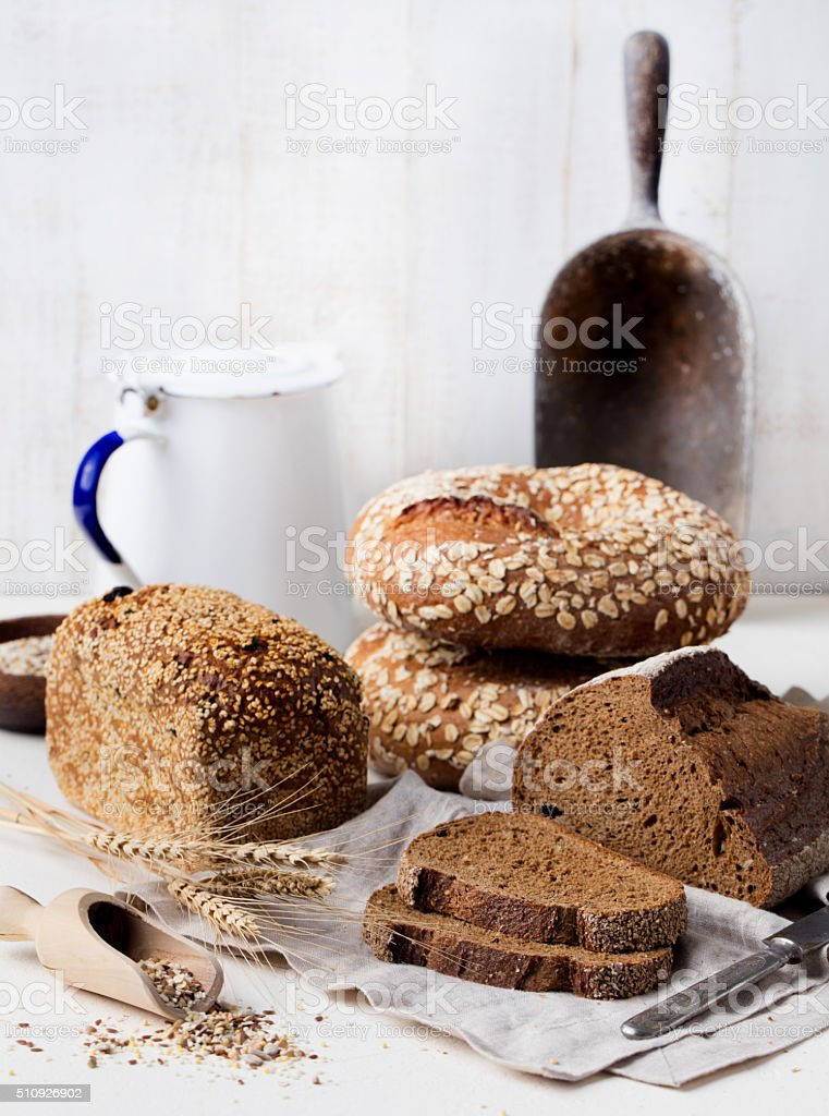 Assortment of rustic bread on wooden table stock photo