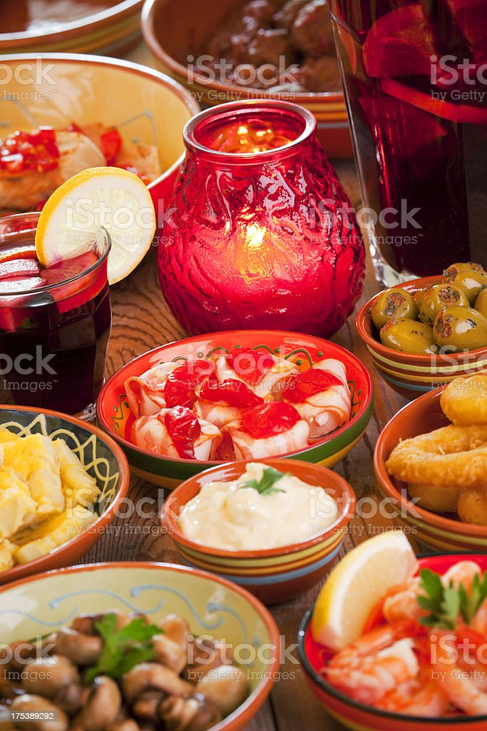 Assortment of Spanish tapas and sangria on a rustic table royalty-free stock photo