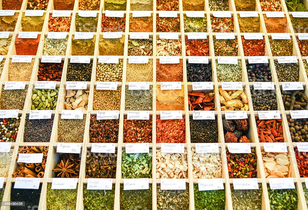 Assortment of spices in wooden box stock photo