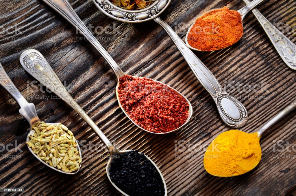 Assortment of spices, vintage spoons stock photo