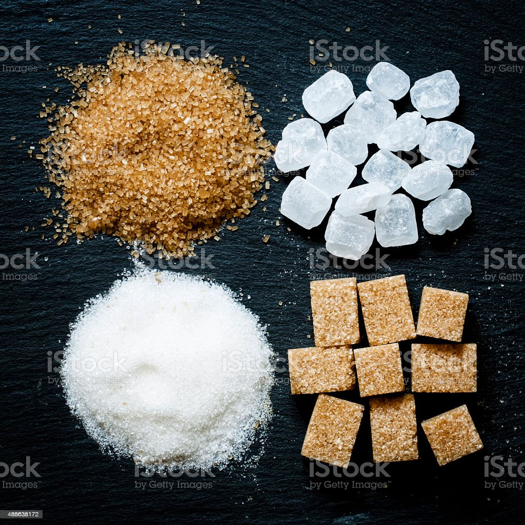 Assortment of sugar: white sand, candy sugar, brown sugar stock photo