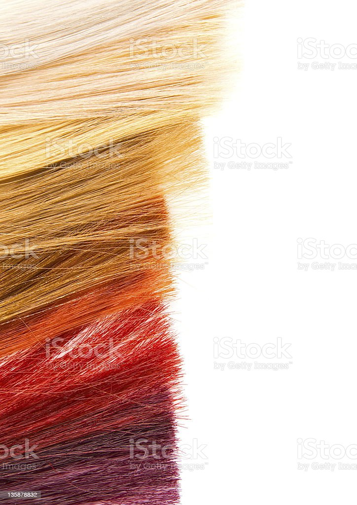 Assortment of warm colored dyed hair locks  stock photo