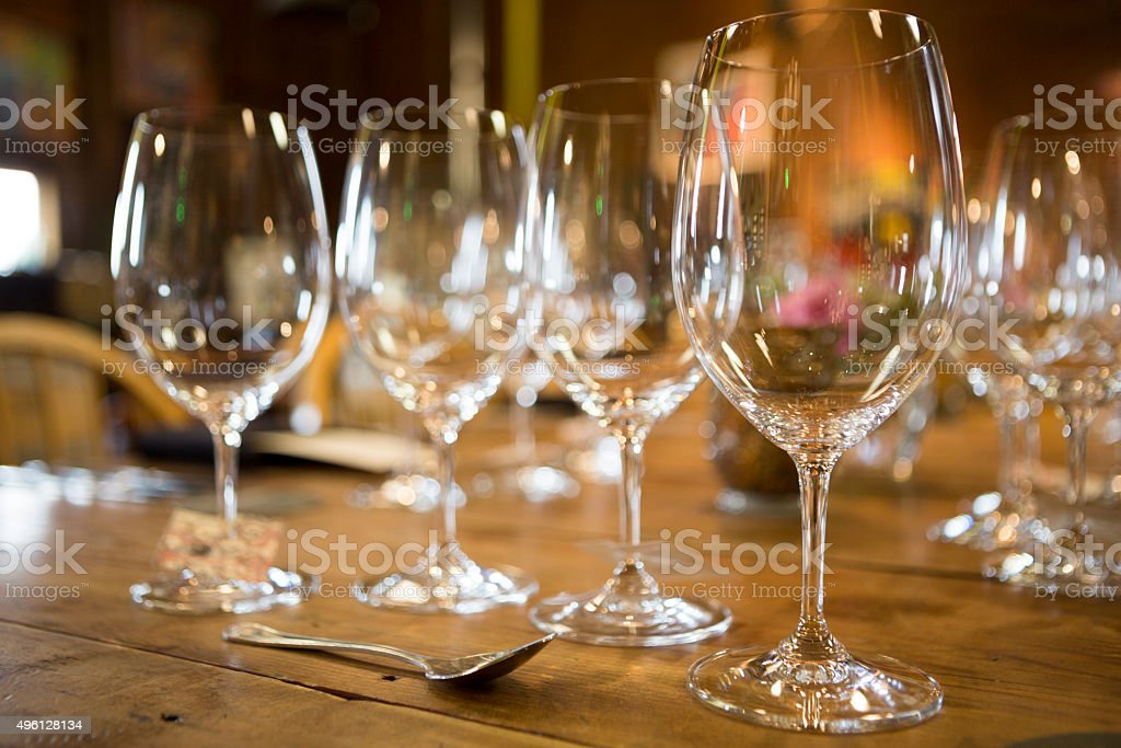 Assortment of wine glasses on old wooden dinner table stock photo