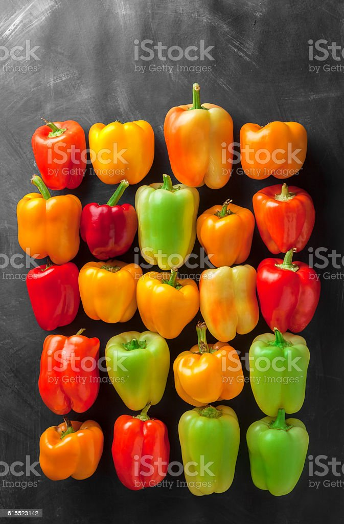 Assortment overhead group of colorful lined up bell peppers stock photo