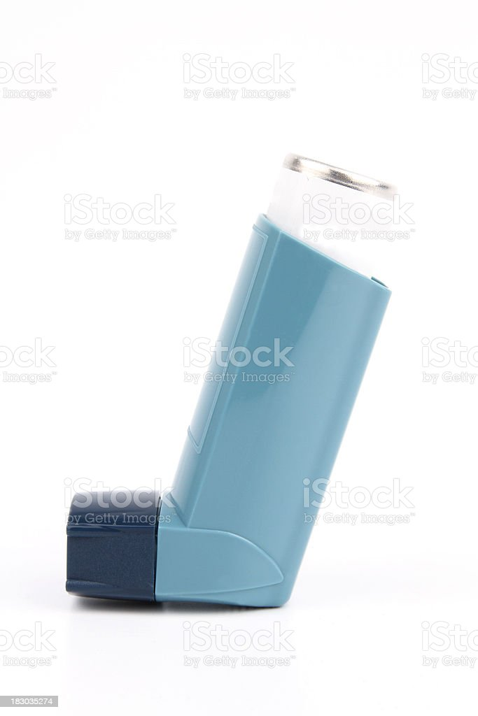 Asthma inhaler with a blue cover stock photo