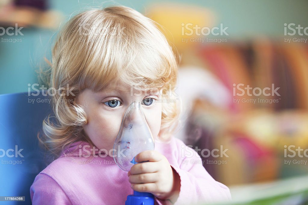 Asthma relieving inhalation stock photo
