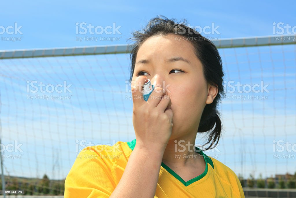 Asthma Soccer Player stock photo