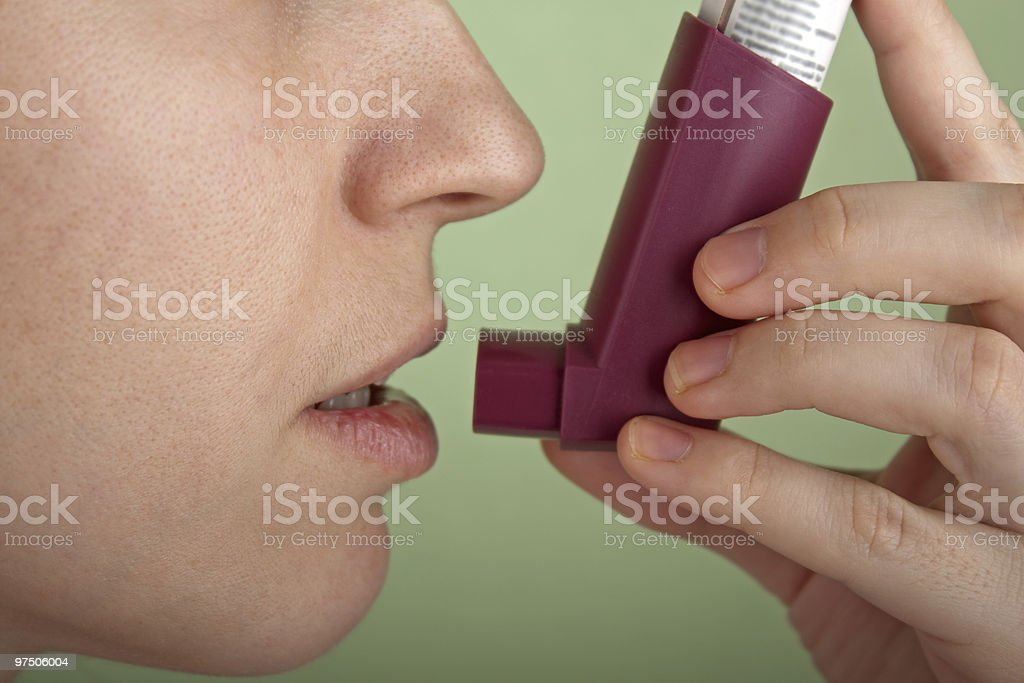 Asthmatic inhaler stock photo