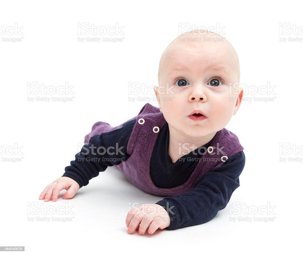 astonished baby on floor stock photo