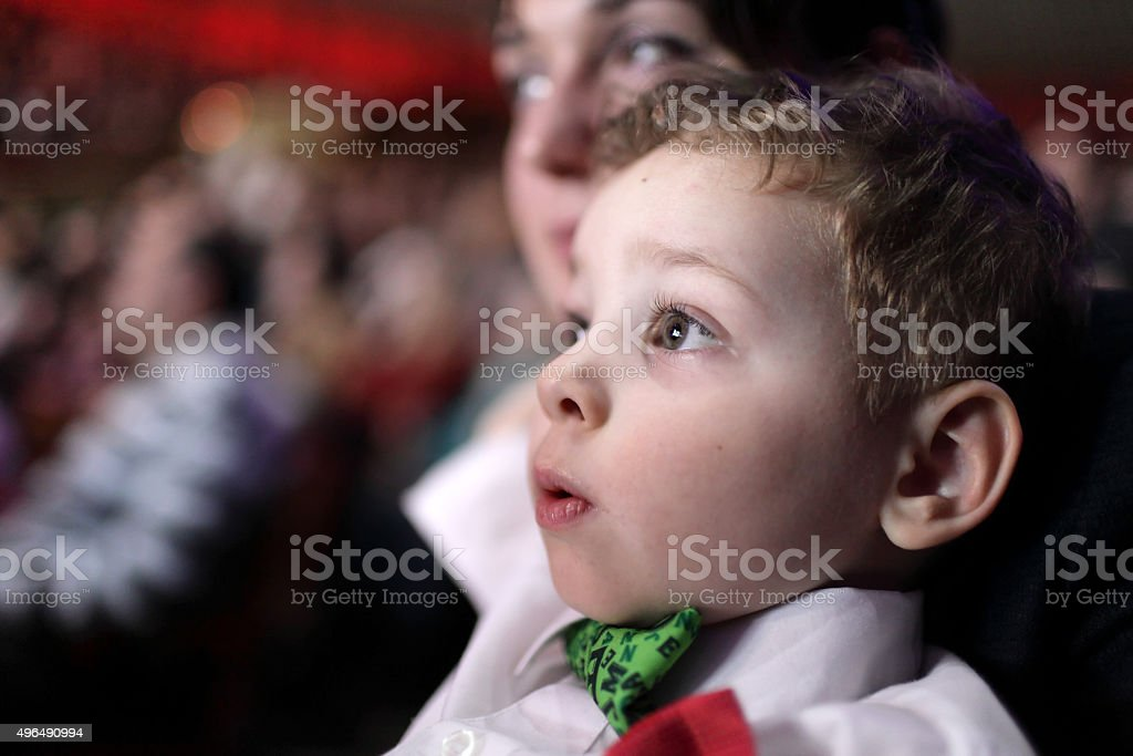 Astonished child at circus stock photo
