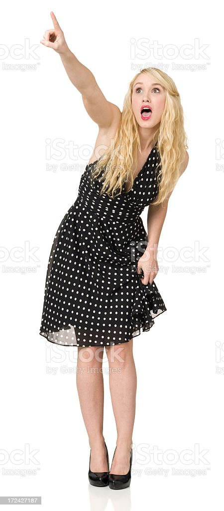 Astonished Woman Pointing Up royalty-free stock photo