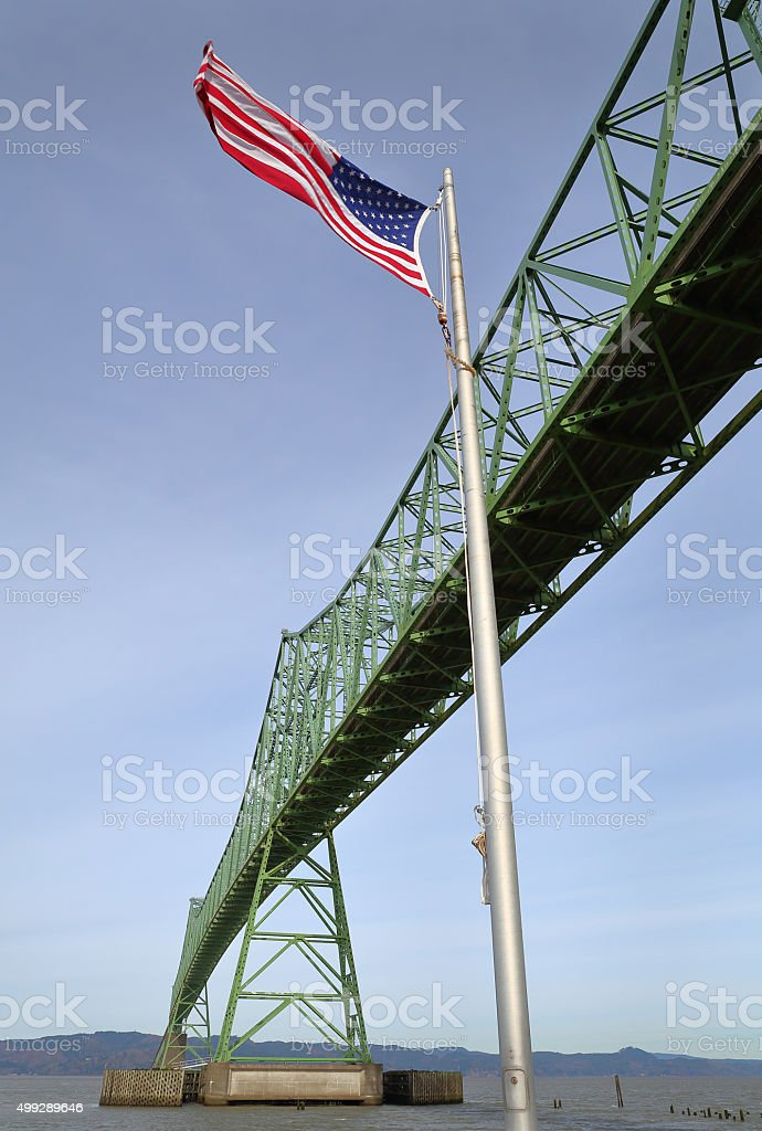 Astoria Bridge and Flag, Oregon stock photo