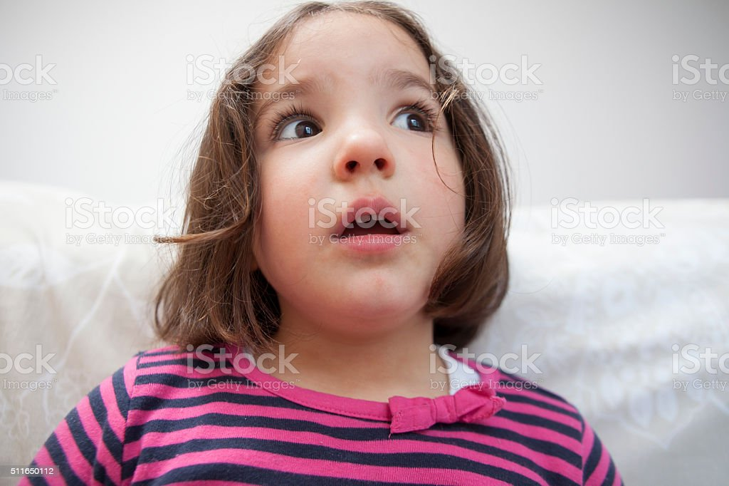 Astounded three years old  little girl stock photo