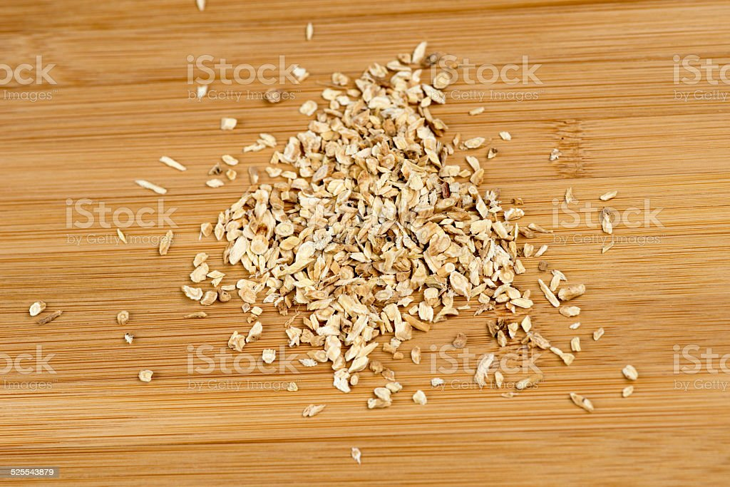 Astragalus membranaceus against a wooden board stock photo