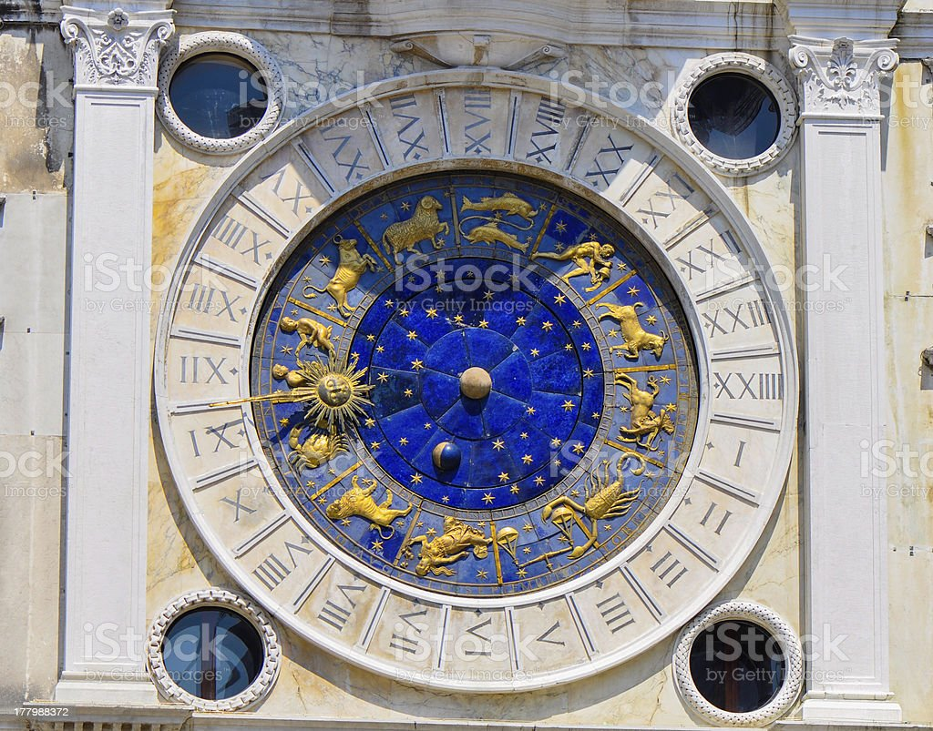 Astrology clock on the side of St. Marco square stock photo