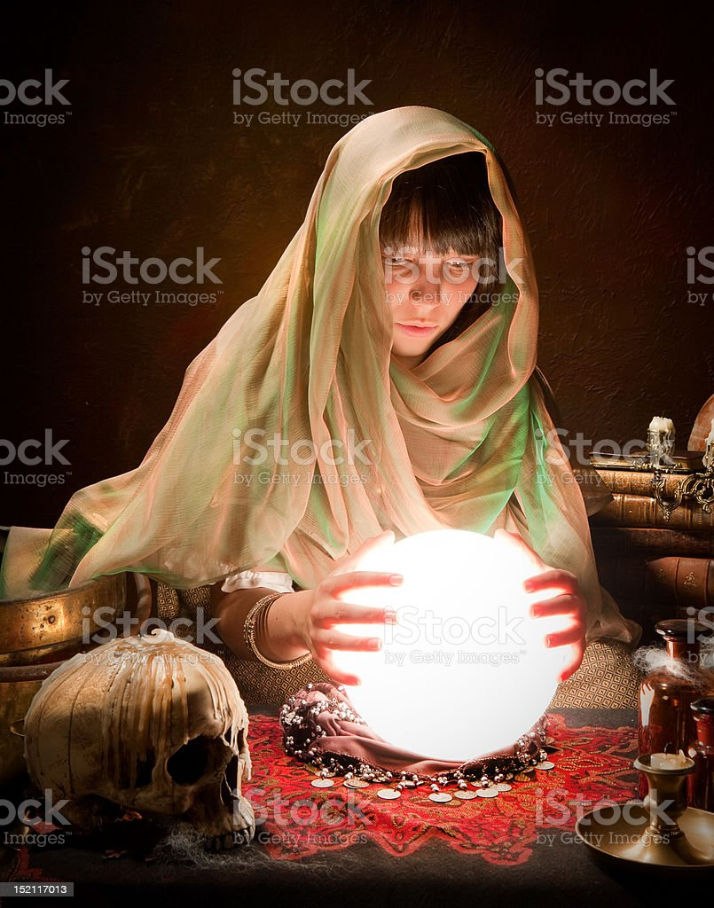 Astrology gypsy with crystal ball stock photo