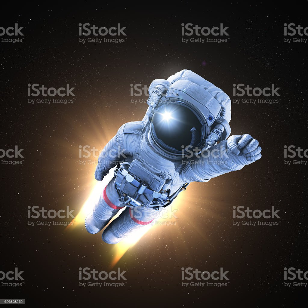 Astronaut conquers outer space stock photo