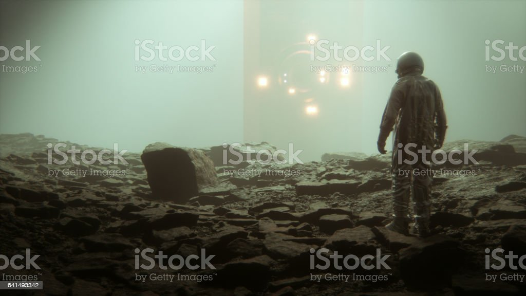 Astronaut discovering alien artefact stock photo