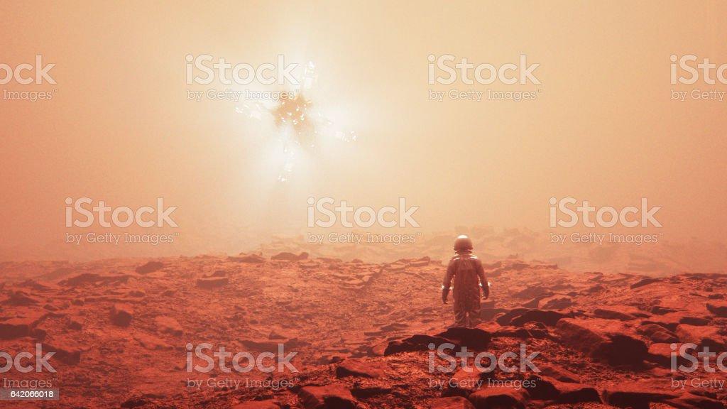 Astronaut discovering alien UFO stock photo