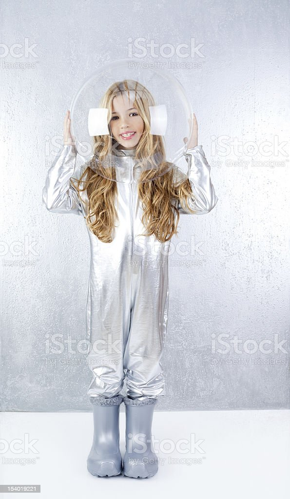 Astronaut girl with silver uniform and glass helmet stock photo