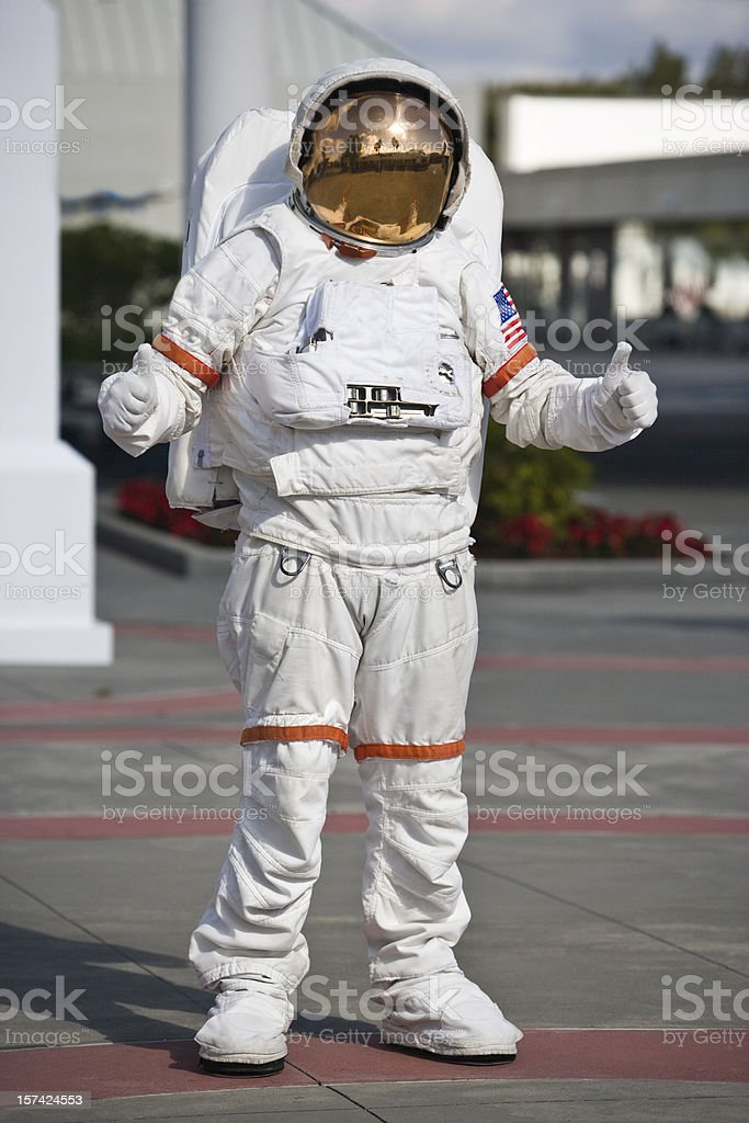 Astronaut giving a thumbs up royalty-free stock photo