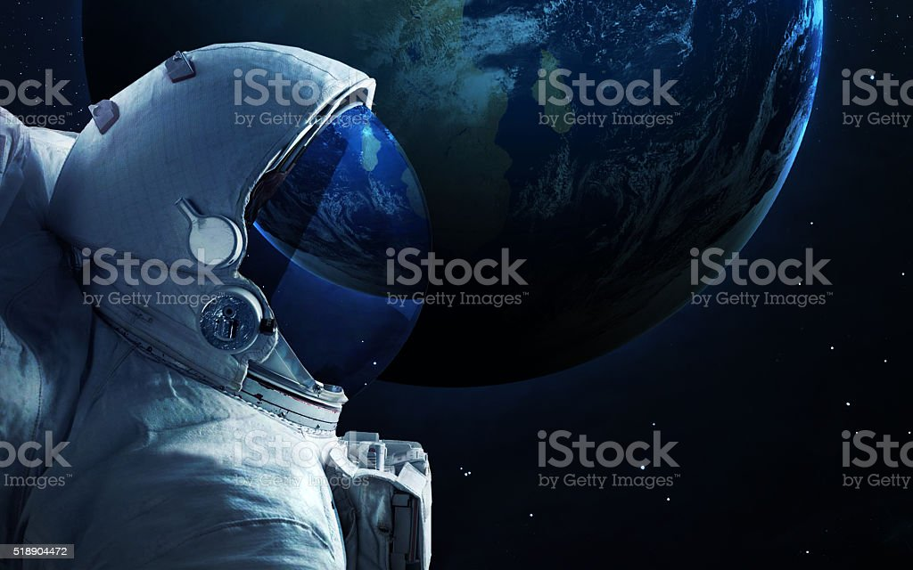 Astronaut in outer space. Spacewalk. Elements of this image furnished stock photo
