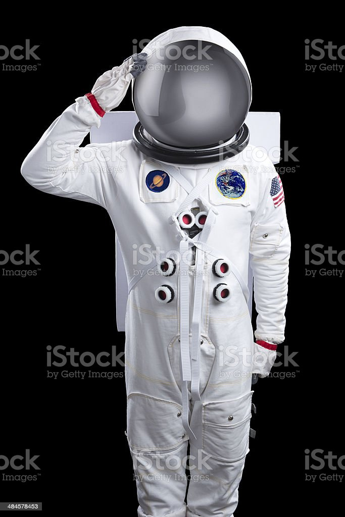 Astronaut Isolated on Black Saluting stock photo
