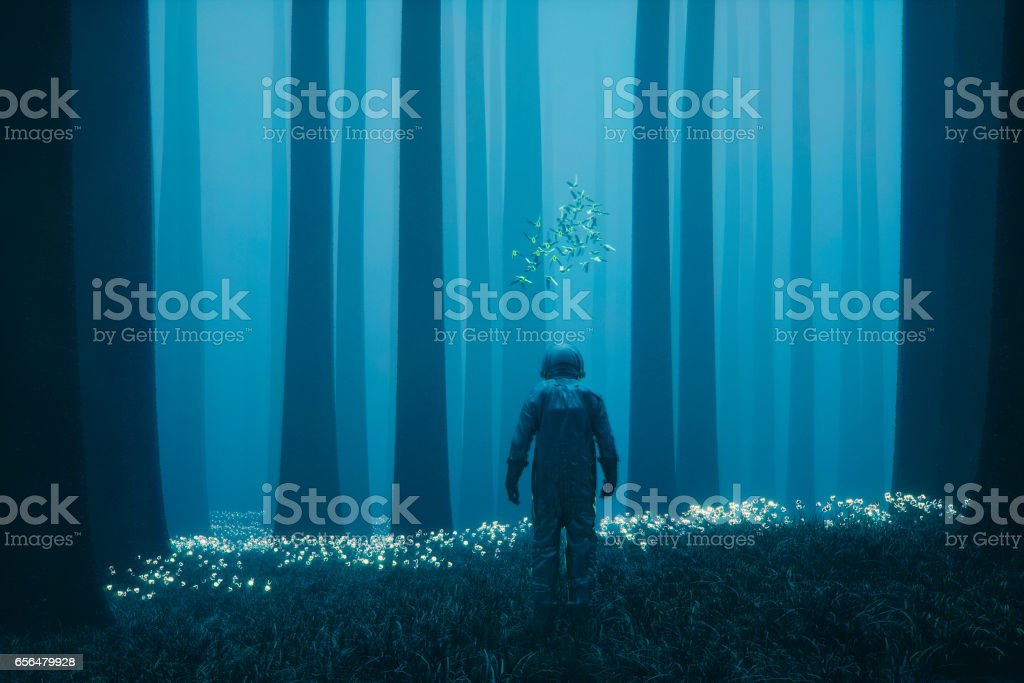 Astronaut lost in the forest on alien planet stock photo