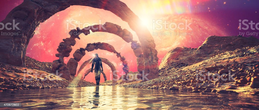Astronaut on distant planet walking in the river stock photo