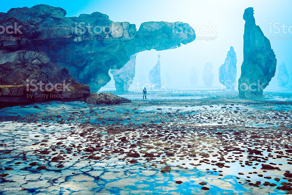 Astronaut on strange, rocky alien planet stock photo
