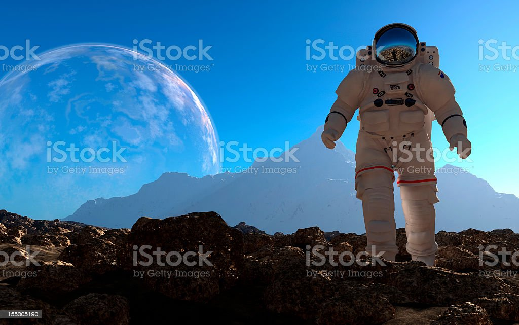 Astronaut standing on a planet in space suit stock photo