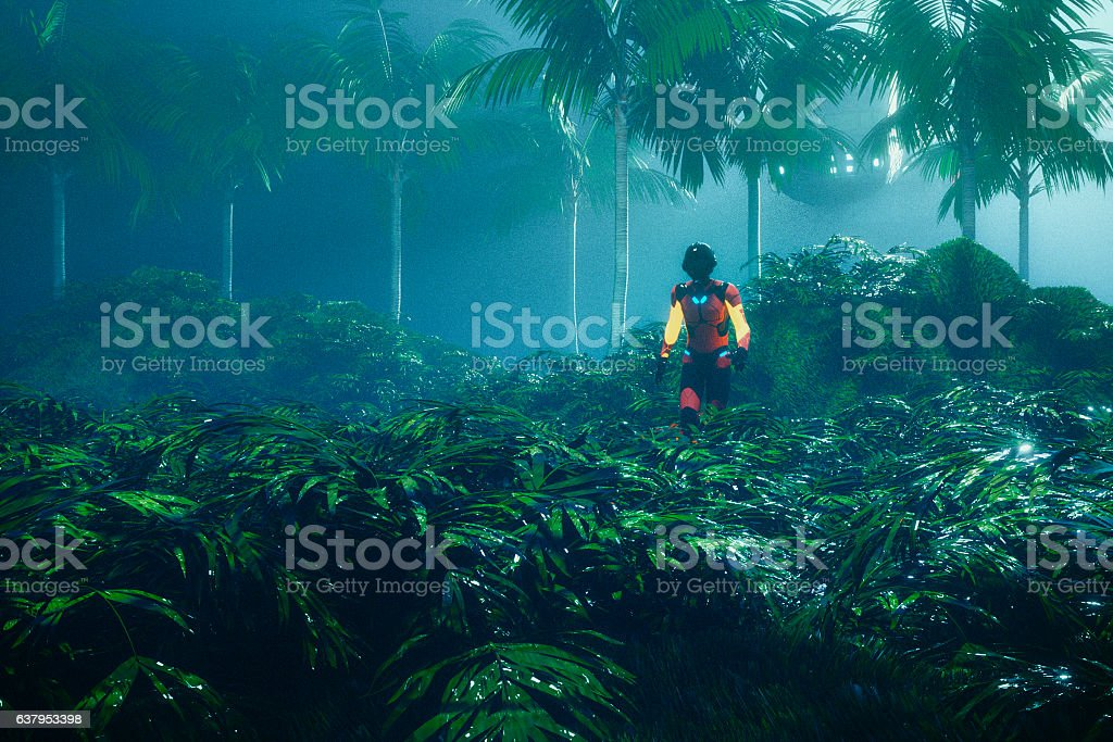 Astronaut walking in jungle on distant planet stock photo
