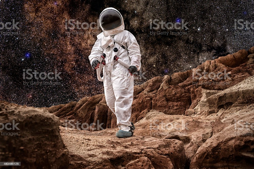 Astronaut Walking On Mars or the Moon stock photo