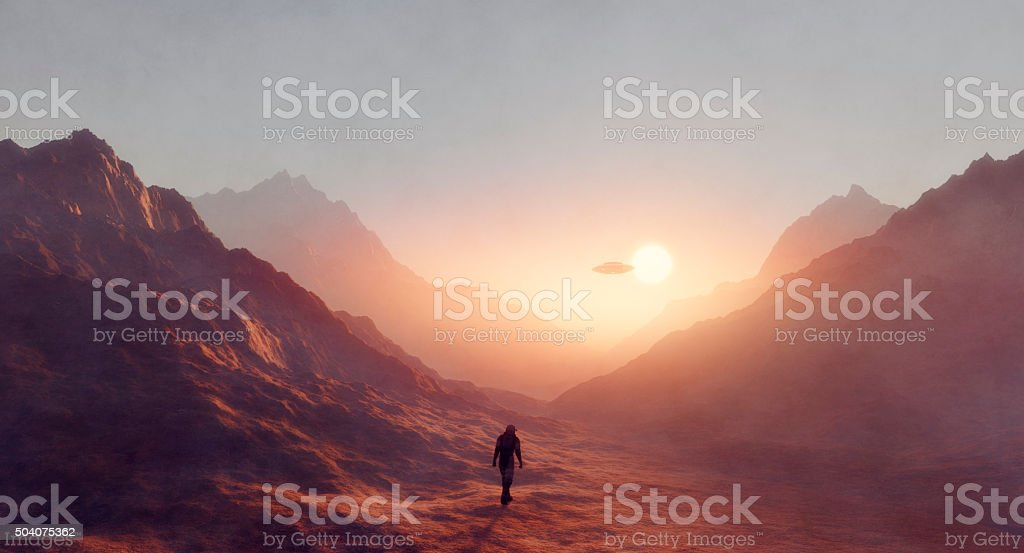 Astronaut walking on Mars, UFO flying stock photo