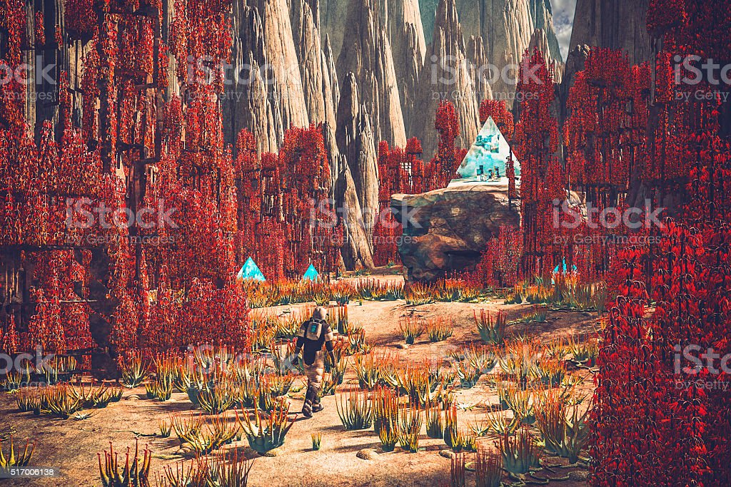 Astronaut walking on mysterious planet stock photo