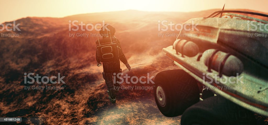 Astronaut with space vehicle exploring distant planet stock photo