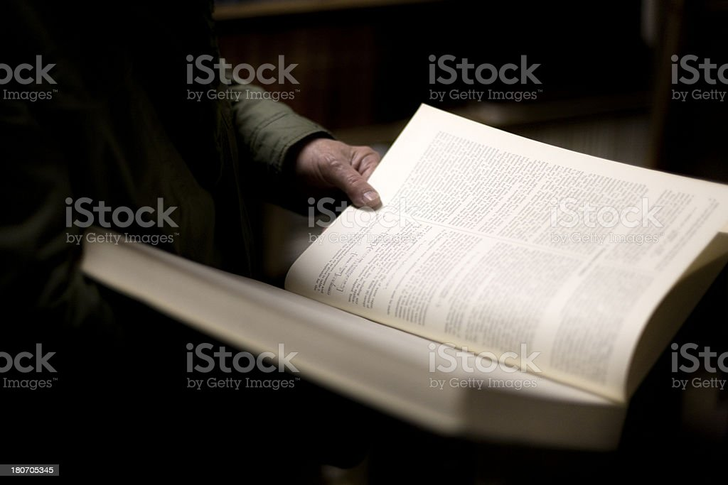Astronomer holding an astronomy textbook royalty-free stock photo