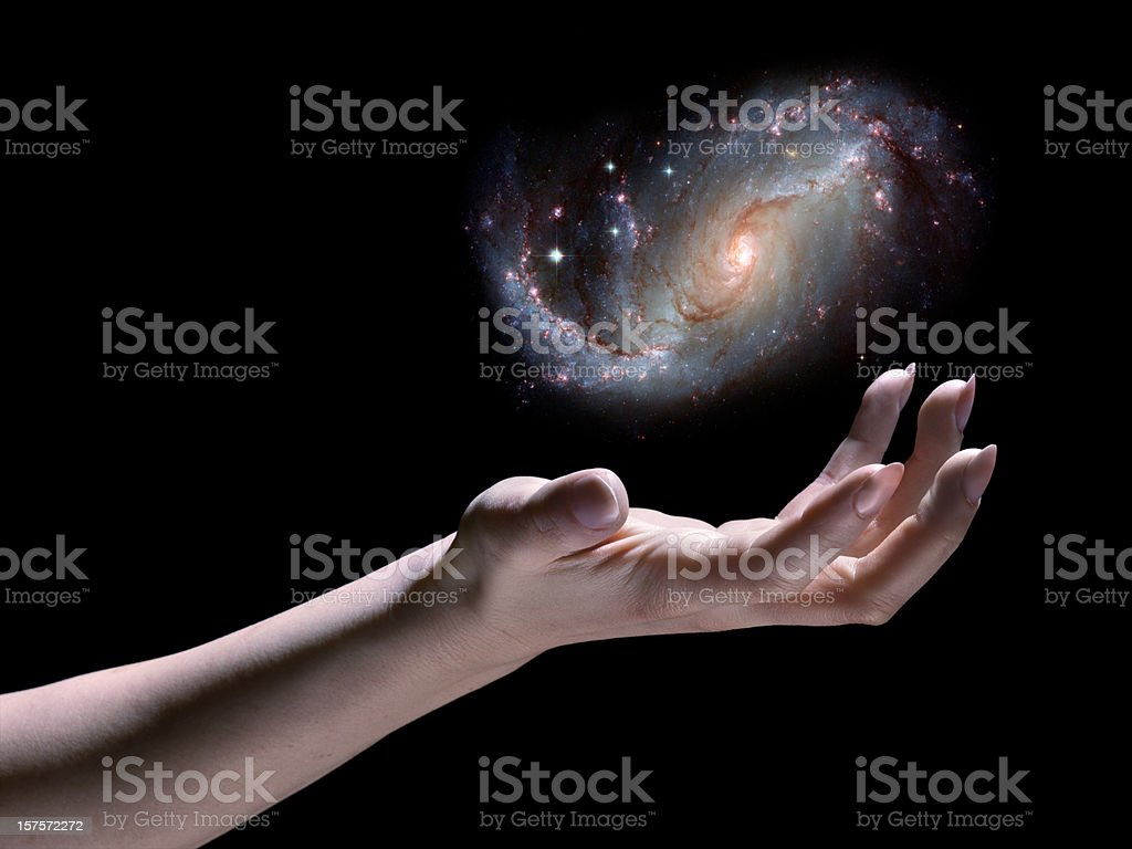 Astronomer; Spiral Galaxy in Hand, Black Background, Science Fiction, God stock photo