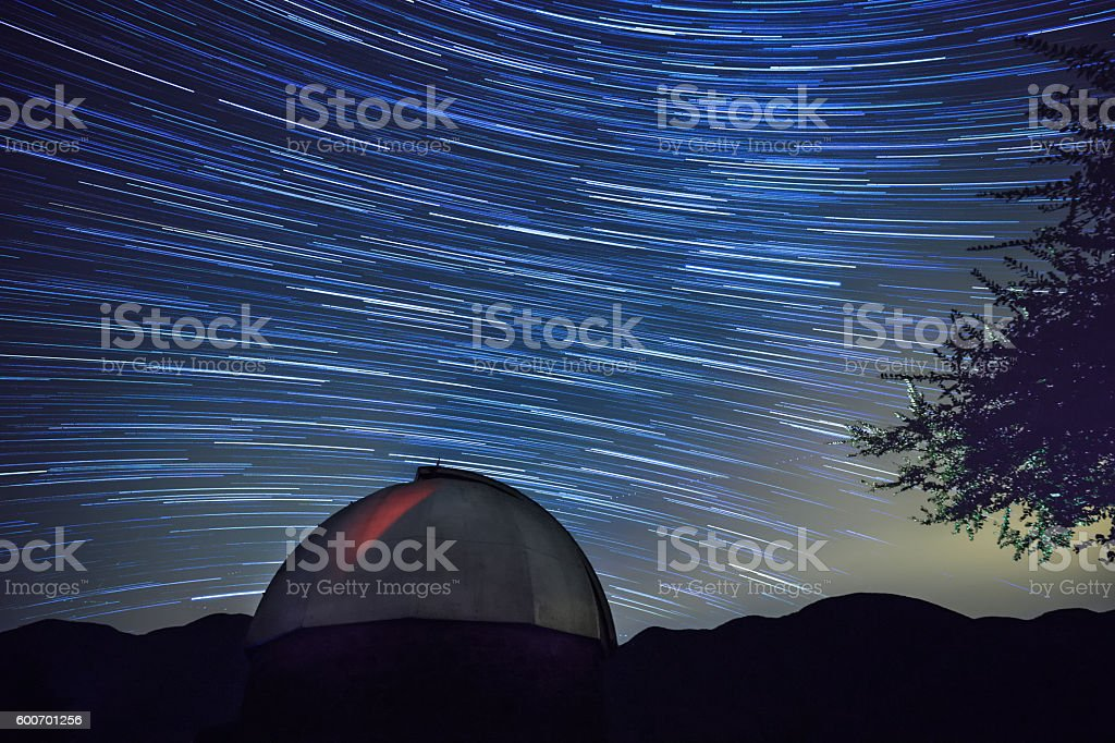 Astronomical Observatory At Night - Star Trail On The Background stock photo
