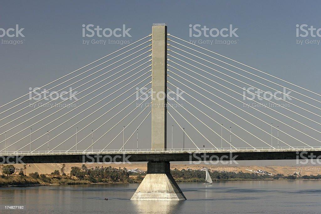 Aswan Bridge and felucca on Nile River royalty-free stock photo