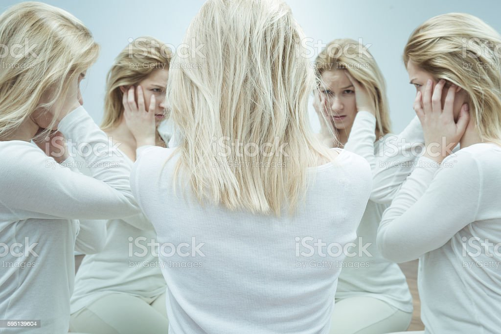 Asylum patient with dual personality stock photo